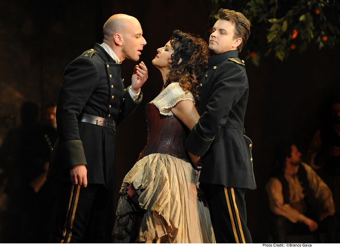 Adrian Tamburini as Zuniga, Nancy Fabiola Herrera as Carmen and Dmytro Popov as Don Jose in CARMEN. Pic Branco Gaica