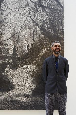 Daniel Boyd next to his Bvlgari Award winning painting. Pic Jenni Carter