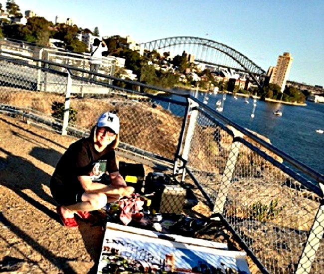 Artist Shirley Peters at work with the beautiful backdrop of Sydney Harbour