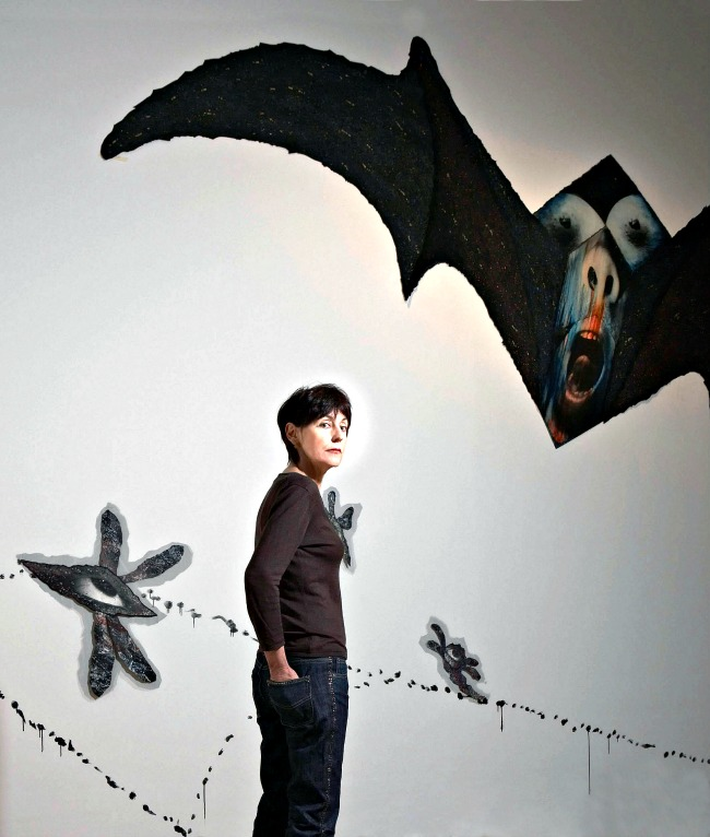 Annette Messager in front of her work 'Chimeres/Chimaeras (c) Annette Messager
