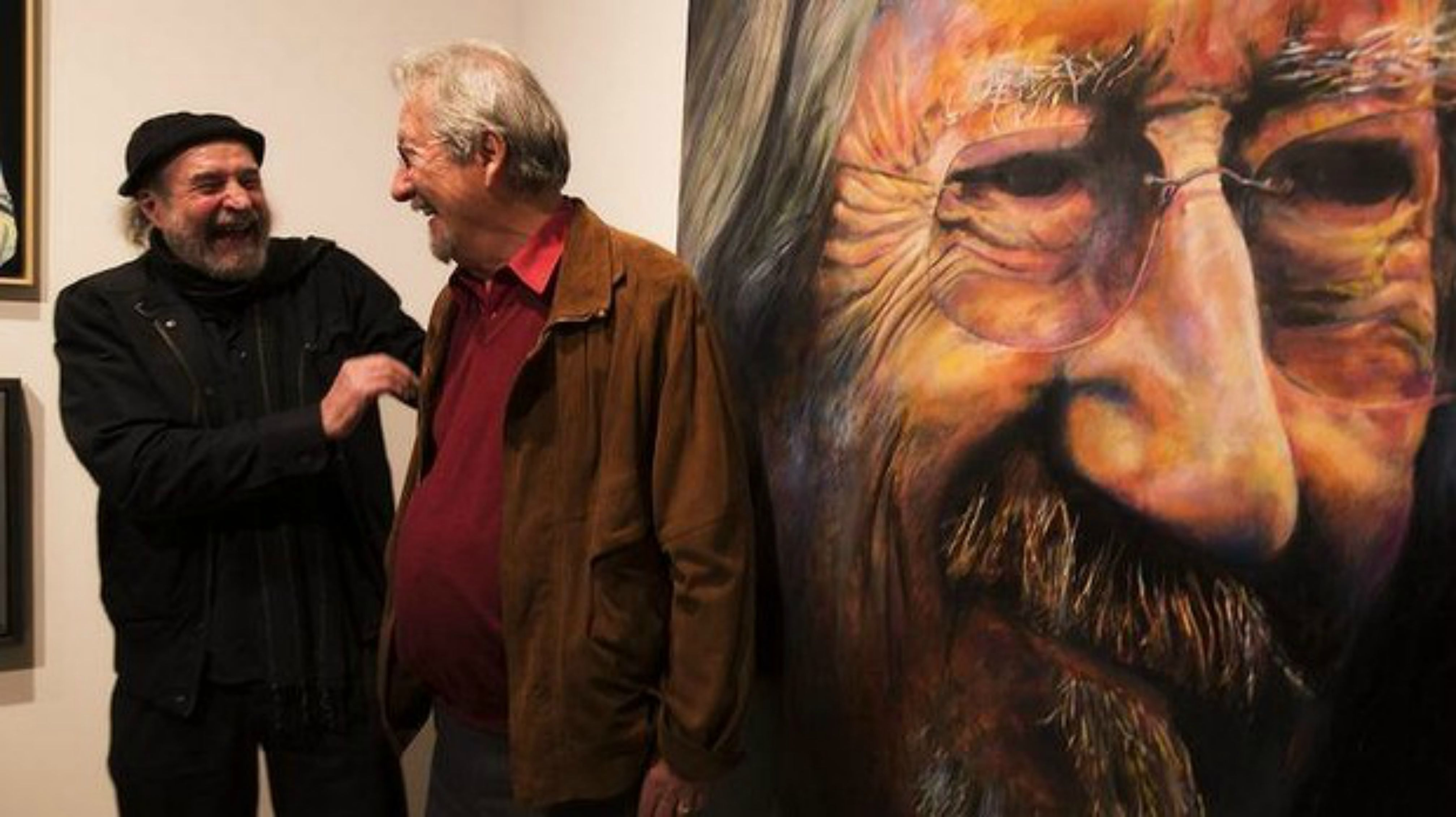 Inset pic- Bruno Jean Grasswill with Michael Caton and his portrait of the actor. Pic Richard Dobson. Featured pic- Archibald winner Nigel Milsom with his subject Charles Waterstreet and the winning work. Pic Steven Siewert