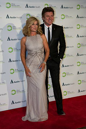 Inset pic- Emcees Deborah Hutton and Richard Wilkins. Featured pic- Olivia Newton John and her husband