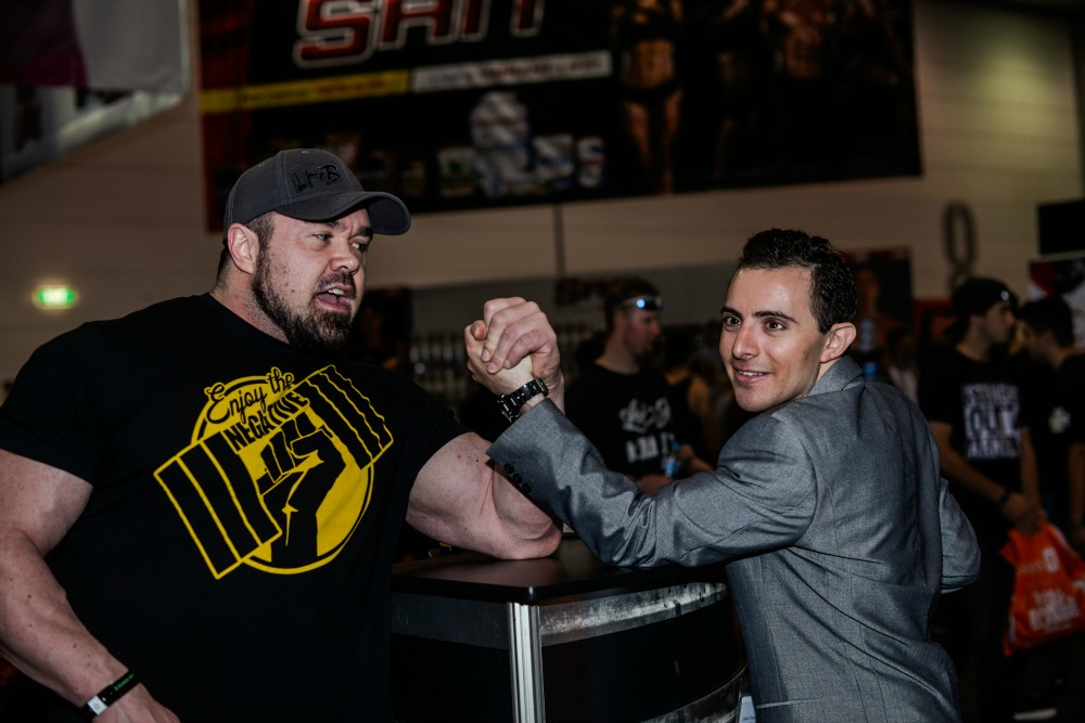 Jake Freeman has a friendly encounter with one of the bodybuilders at the exhibition.